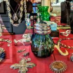 An eclectic blend of jewelry, collectibles, essential oils, decorative flags and crystals